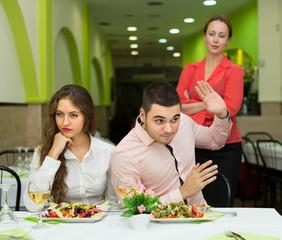 Unpleased couple in restaurant