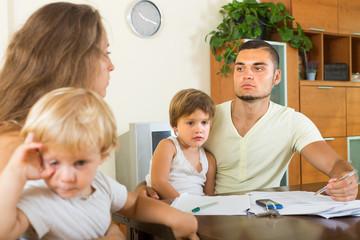 Parents with children having quarrel