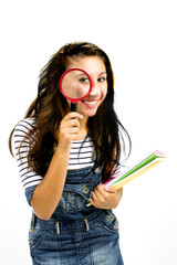 Beautiful smiling girl with magnifying glass