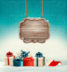 Christmas background with a retro wooden sign and gift boxes. Ve