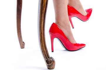 Woman wearing red high heel shoes