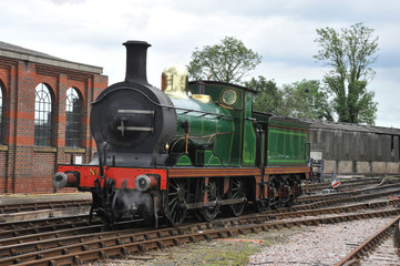 20 th century steam engine at a station in Sussex.