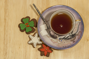 Cup Of Tea with Sugar and Gingerbread Cookies