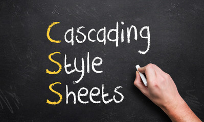 hand writing cascading style sheets on a chalk board