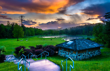 Sunset over building and ponds at Delaware Water Gap National Re