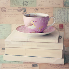 Vintage tea cup over books