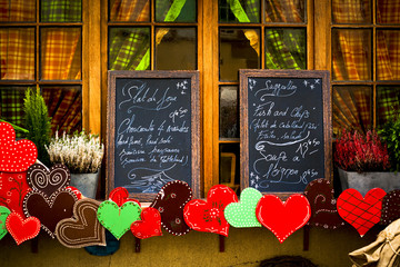 Festive menu boards in front of cozy window
