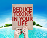 Reduce Toxins In Your Life card with a beach background poster