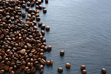 Coffee beans on a slate background