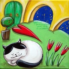 Cat Sleeping In A Courtyard