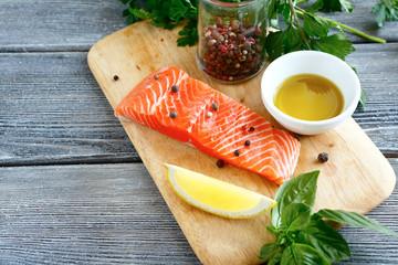 Raw fresh fish on a wooden board