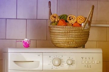 Washing machine with towels in basket