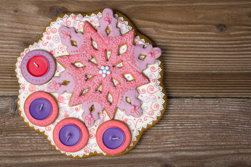 Gingerbread star with candle on wooden background