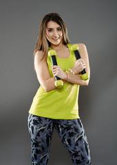 Fitness lady doing cardio dance