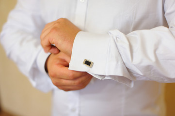 men wear cufflinks on a shirt sleeve