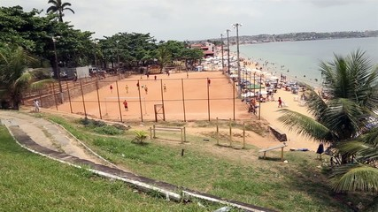 View of Boa Viagem Beach with a soccer field in Salvador, Brazil