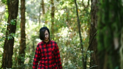 Hipster girl exploring the forest