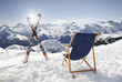 Cross ski and Empty sun-lounger at mountains
