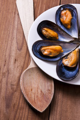 prepared mussels on wooden background