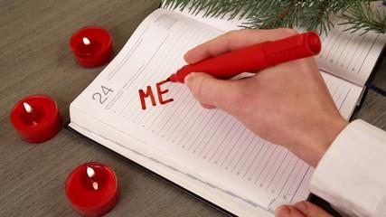 hand writing merry christmas organizer