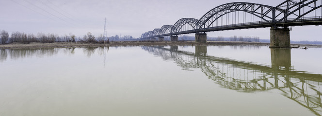 Gerola Bridge on the Po river, wintertime. Color image