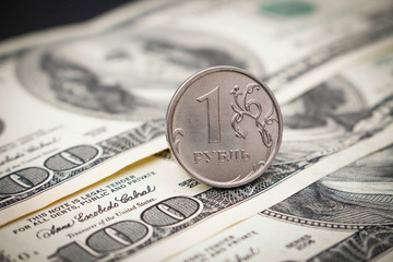 Russian ruble on the background of hundred dollar