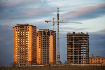 Building site against sunset sky