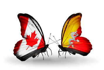 Two butterflies with flags Canada and Bhutan