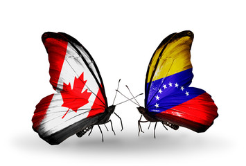 Two butterflies with flags Canada and Venezuela