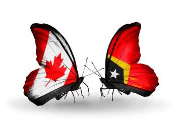 Two butterflies with flags Canada and  East Timor