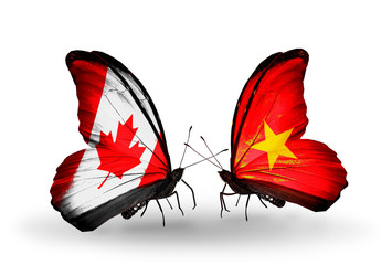 Two butterflies with flags Canada and Vietnam