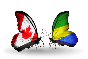 Two butterflies with flags Canada and Gabon