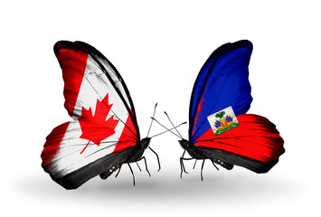 Two butterflies with flags Canada and Haiti