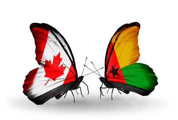 Two butterflies with flags  Canada and Guinea Bissau