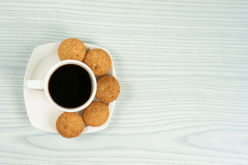 Coffee cup with homemade oatmeal cookies