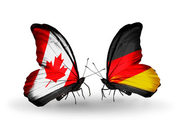 Two butterflies with flags Canada and Germany