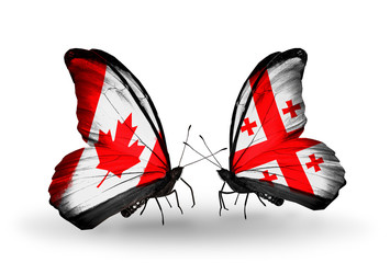Two butterflies with flags Canada and Georgia