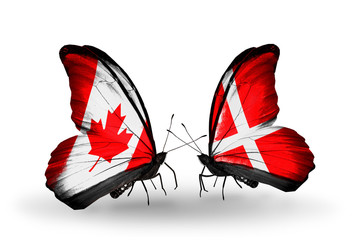 Two butterflies with flags Canada and Denmark