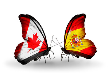 Two butterflies with flags Canada and Spain