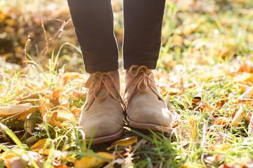 stylish boots on autumn background