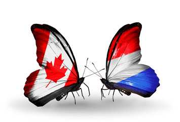 Two butterflies with flags Canada and Luxembourg