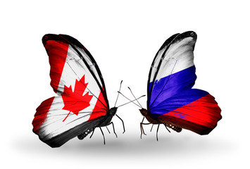 Two butterflies with flags Canada and Russia