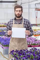 Male Garden Worker Holding an Open Signboard