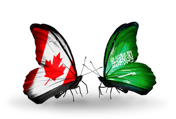 Two butterflies with flags Canada and Saudi Arabia