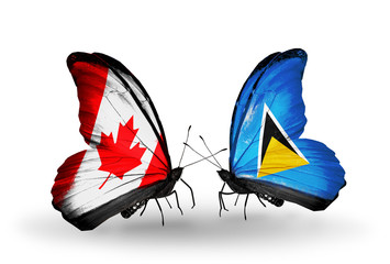 Two butterflies with flags Canada and Saint Lucia