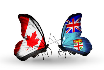 Two butterflies with flags Canada and Fiji