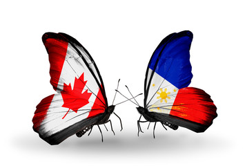 Two butterflies with flags Canada and Philippines