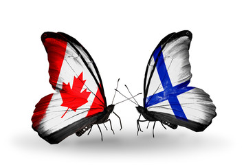 Two butterflies with flags Canada and Finland