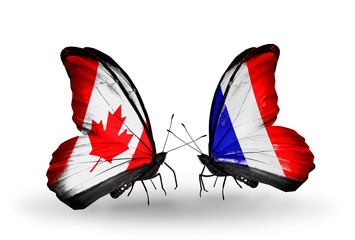 Two butterflies with flags Canada and France
