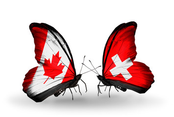 Two butterflies with flags Canada and Switzerland